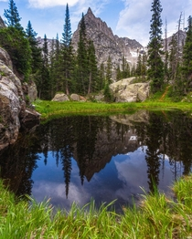 A still dark pond reflects the scene of mountain majesty I smiled here Location Colorado USA  ignatureprofessor
