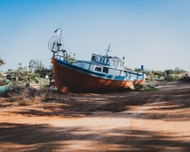 A stranded boat in a random village in cyprus