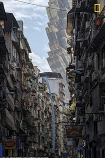 A street in Macau with the Grand Lisboa Casino looming in the background Photograph by Paul Tsui National Geographic travel photographer of the year