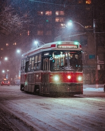 A streetcar making its way along Carlton street in Toronto Ontario