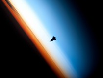 A stunning silhouette of the Space Shuttle Endeavour over Earths horizon Photo shot from the ISS