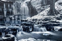 A stunning snapshot of the Frozen Scaleber Falls in the Yorkshire Dales National Park England by Chris Frost