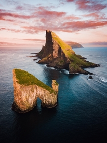 A stunning sunrise in the Faroe Islands looking towards the incredible Tindholmur and neighbouring sea stack Drangarnir  IG - dom_reardon_photo