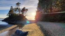 A sunset at Tonquin Beach in Tofino British Columbia Canada   x