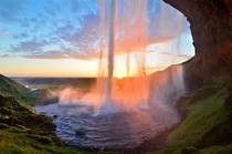 A sunset from behind Seljalandsfoss waterfall Iceland  photo by David Shield