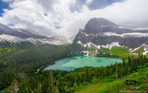 A teal lake and stunning mountain in Glacier National Park Montana