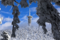 A telecommunications tower is seen on the top of a snow-covered slope on Mount Parnitha near Athens Greece on January