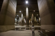 A tourist views the enormous pressure-adjusting underground water tank during a tour of the Metropolitan Area Outer Underground Discharge Channel facility in Tokyo Japan Chris McGrath