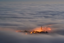 A town shrouded in fog on the Asiago Plateau Italy