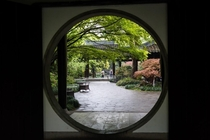 A traditional Chinese moon gate to a garden in Hangzhou China