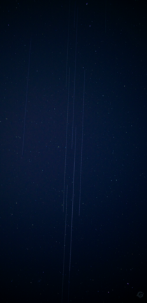 A train of Starlink satellites passing over Toronto tonight