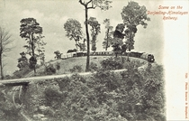 A train on a remarkable section of the Darjeeling Himalayan Railway The upper part of the loop - the fourth on the line - was originally a curve of  ft radius Improvements have been made but this loop is still known as Agony Point where trains almost over