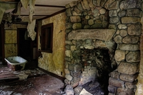 A tub and stone fireplace at a mountain hotel once used by Theodore Roosevelt OC x