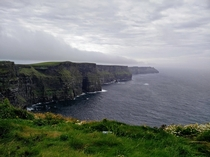 A typical grey Irish day at the Cliffs of Moher County Clare Ireland This is the view about  kilometres about  miles hike north of the visitors centre We spent an hour here completely alone just taking in every detail