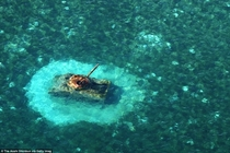 A United States M Sherman tank remains in shallow water off Chalan Kanoa beach in Saipan Northern Mariana Islands