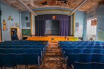 A very colorful abandoned school auditorium