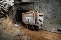A very old handmade ore car in an abandoned mine