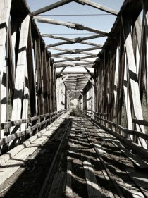 A view down the tracks Closed train bridge near East Coulee Alberta  x