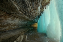 A view from behind a frozen Minnehaha Falls  X
