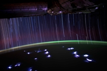 A view from the ISS - Star trails and satellite flashes above lightning storms below