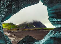 A view of Iceland seen from inside a melting ice-cave