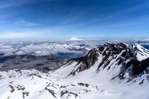 A view of Mount St Helens crater from the summit with Mount Rainer in the distance