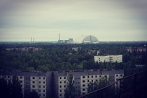 A view of the Vladimir I Lenin NPP Chernobyl NPP from the roof of a  story apartment block in Prypiat Ukraine Image taken th Aug