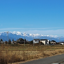 A village with the Japanese Alps in the background Nagano Prefecture Japan