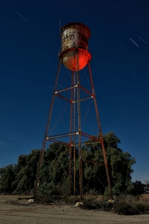 A water tower stands sentry over an abandoned farm in the vast agricultural area south of Californias Salton sea Photographed by Eyetwist