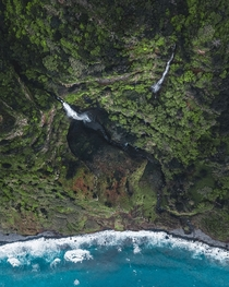 A waterfall in Madeira leading directly into the Atlantic Ocean
