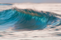A wave at sunrise with a bit of slow shutter Sandy Beach Oahu Hawaii