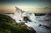 A wave crashes against the rocks  Photographed by Alfonso Maseda Varela