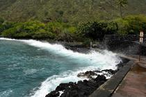 A wave hitting into Kealakekua Bay HI