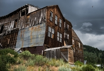 A weathered and beaten hotel lies in the forgotten town of Silver City Idaho