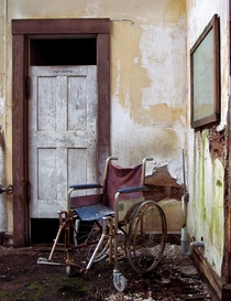 A wheelchair in front of a patients bathroom Taken at the now demolished Repair Shop at the former Foxboro State Hospital