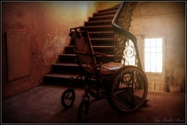 A wheelchair in the abandoned Lyster Sanatorium in Norway  by Jim Andre Aune