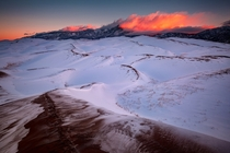 A winter sunrise from the backcountry of Great Sand Dunes National Park Colorado USA -