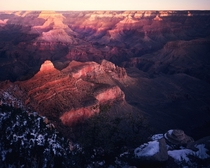 A winter sunrise lights up the depths of the Grand Canyon - Arizona USA