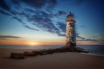 A worn-down lighthouse near Talacre Wales  by Andy Wilson