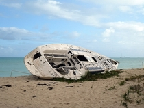 A yacht washed up on a beach in Antigua