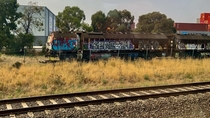 Abandoned and heavily graffitied RG Rail Grinder locomotives left in a railway siding Victoria Australia