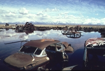 Abandoned automobiles and other debris clutter an acid water and oil filled five acre pond near Ogden Utah in April of  It was cleaned up under EPA supervision to prevent possible contamination of the Great Salt Lake and a wildlife refuge nearby Bruce McA