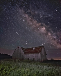 Abandoned barn under the Milky Way
