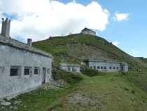 Abandoned barracks of the Italian border guard on Monte ElmoHelm on the border between Italy and Austria Behind them the equally abandoned Helmhaus mountain hut