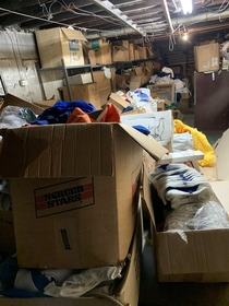 Abandoned basement full of vintage clothing dating back to the s