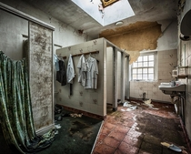 Abandoned bathroom with nurses uniforms remaining in St Brigids psychiatric hospital Ireland