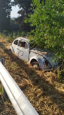 Abandoned beetle near highway in Cyprus