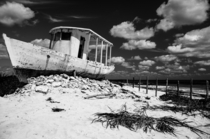 Abandoned boat on the Caribbean coast Punta Morena Cozumel Island Mexico