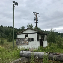 Abandoned building in an old logging yard just off the highway in British Columbia
