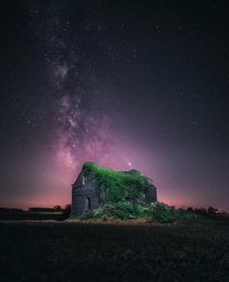 Abandoned building over the night sky